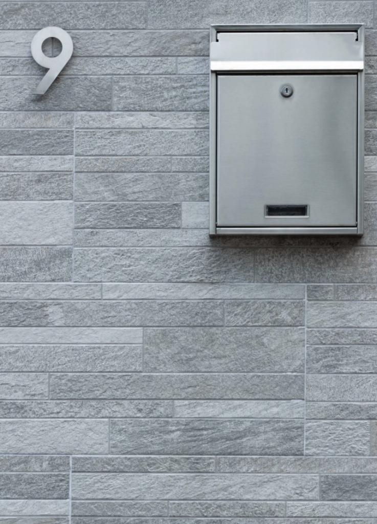 grey mailbox on wall